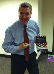 John Foley Holding His New Book - Business Transformation: A New Path to Profit for the Printing Industry